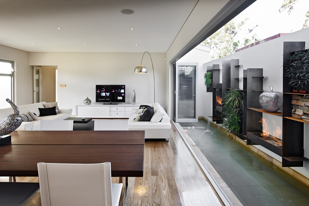 Residential Attitudes - Viento display house - contemporary living room with outside feature