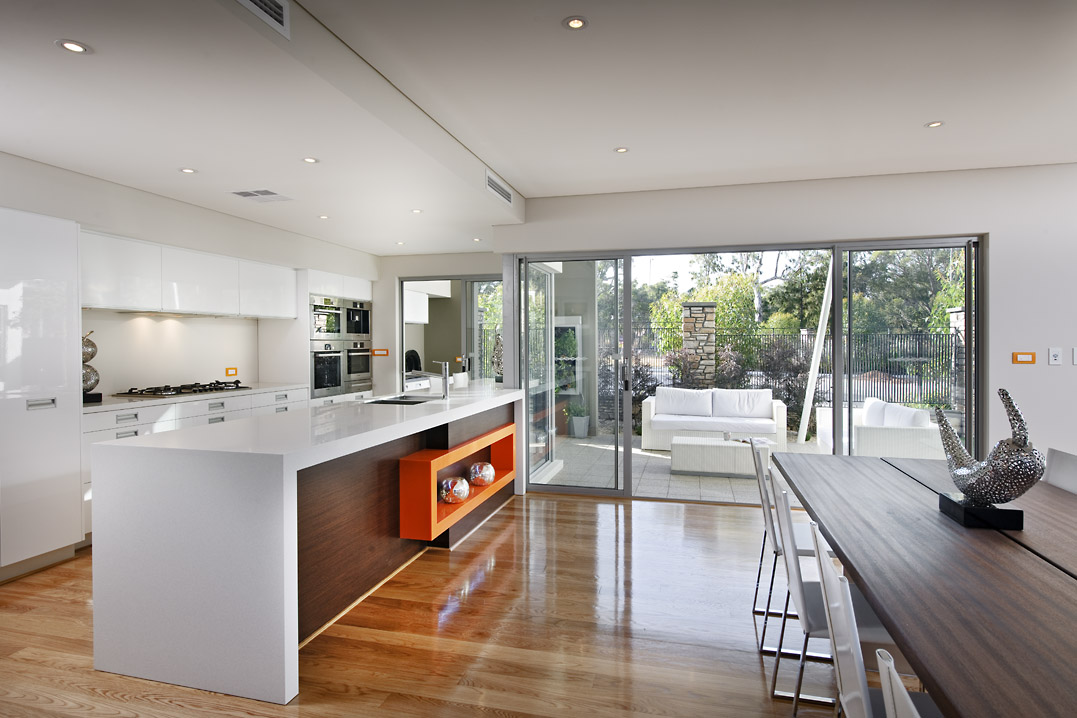 Residential Attitudes - Viento display house - open-plan kitchen and dining room leading out to patio