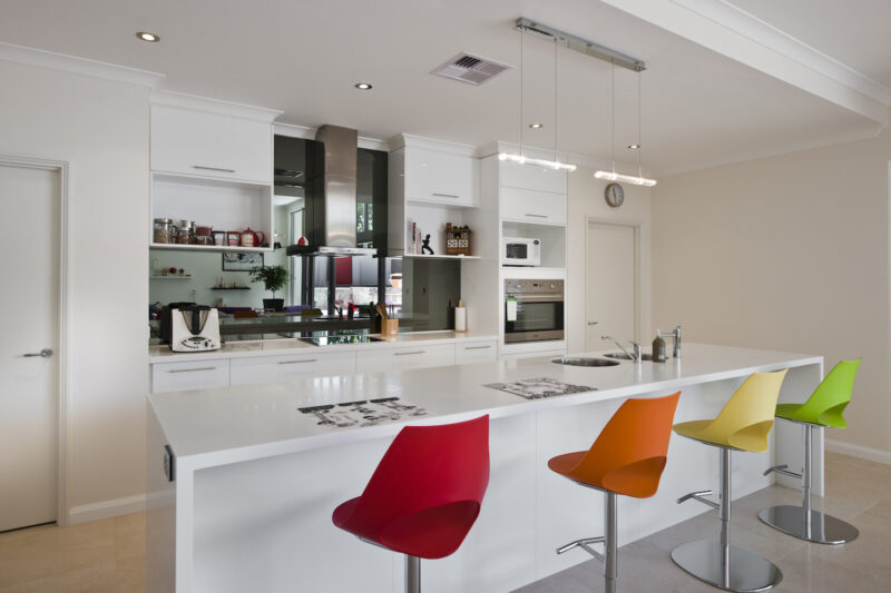Residential Attitudes - modern open-plan kitchen with colourful stools