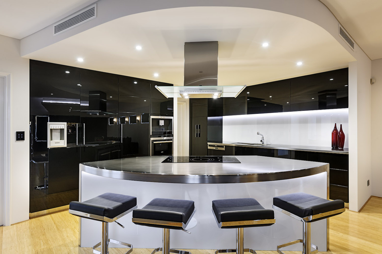 Residential Attitudes - Half circle kitchen with stainless steel kitchen top and stools
