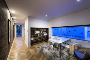 Residential Attitudes - Study with wooden floor, carpet and glass table