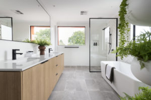Residential Attitudes - Bathroom with tiled floor and ferns