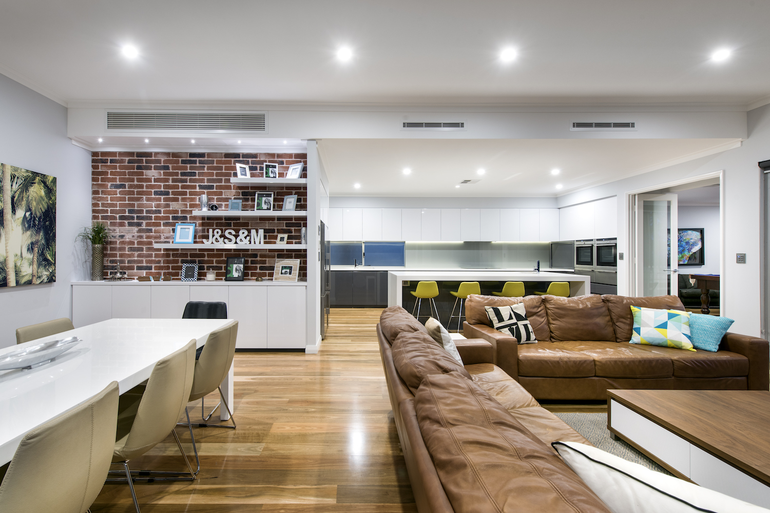Residential Attitudes - Open plan house with dining table, lounge and kitchen