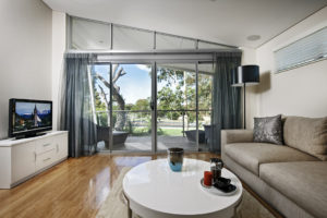 Residential Attitudes - Living room with sliding door looking onto garden