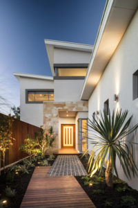 Residential Attitudes - Walkway to front door with lights on