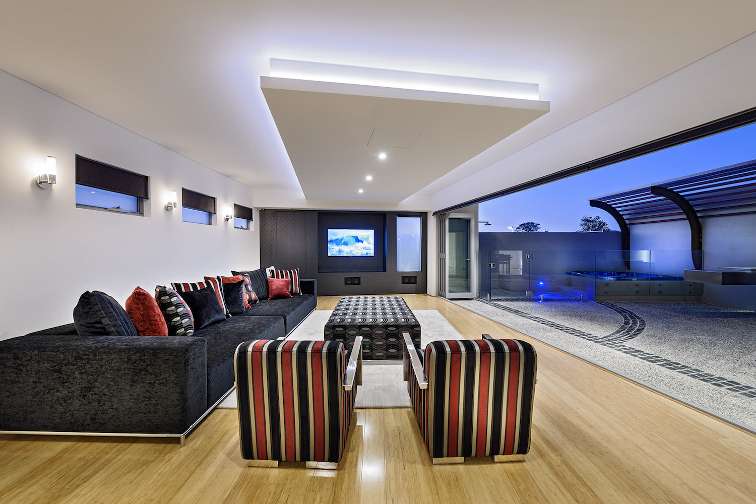 Residential Attitudes - Open plan room with large tv, couche and open doors