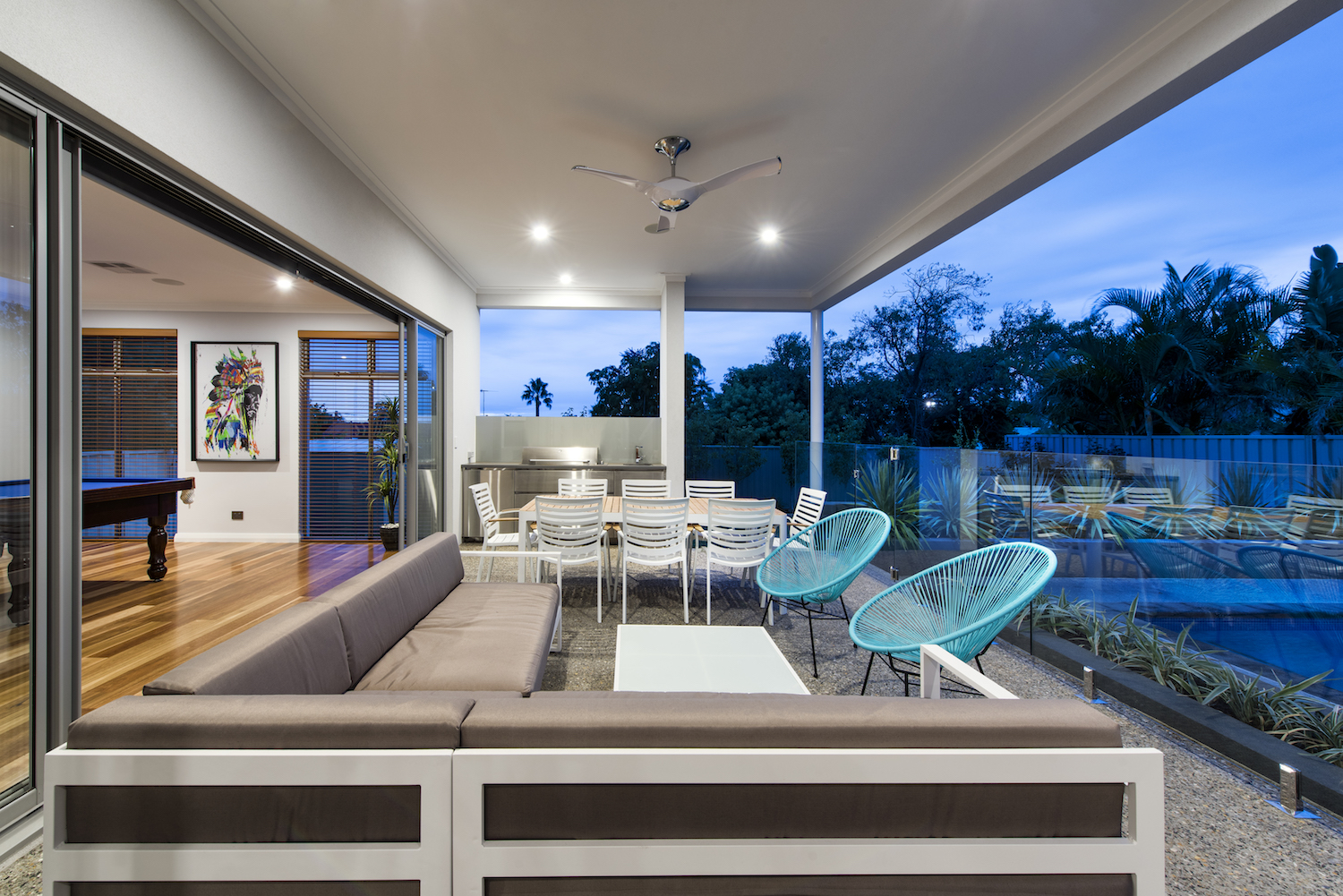 Residential Attitudes - Porch with large couch and dinner table
