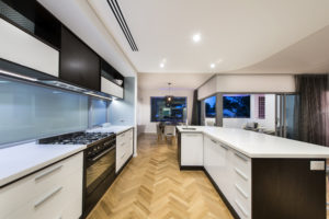 Residential Attitudes - Kitchen with wooden floor and large oven with down-lights