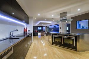 Residential Attitudes - Kitchen with wooden floor and large oven