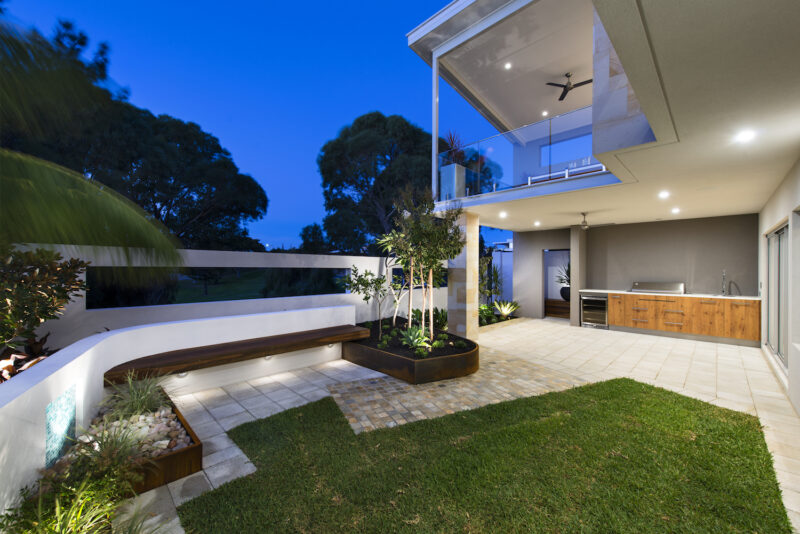 Residential Attitudes - Porch with down-lights and lawn