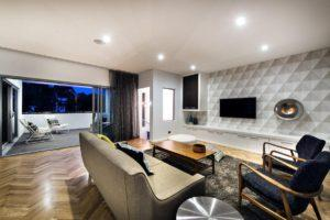 Residential Attitudes - Lounge with large wall TV and wooden floor