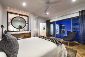 Residential Attitudes - Bedroom with wooden floor and roof fan