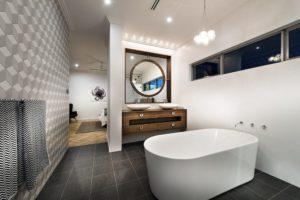 Residential Attitudes - Bathroom with large bath and mirror