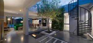 Residential Attitudes - House interior with tree and lights on