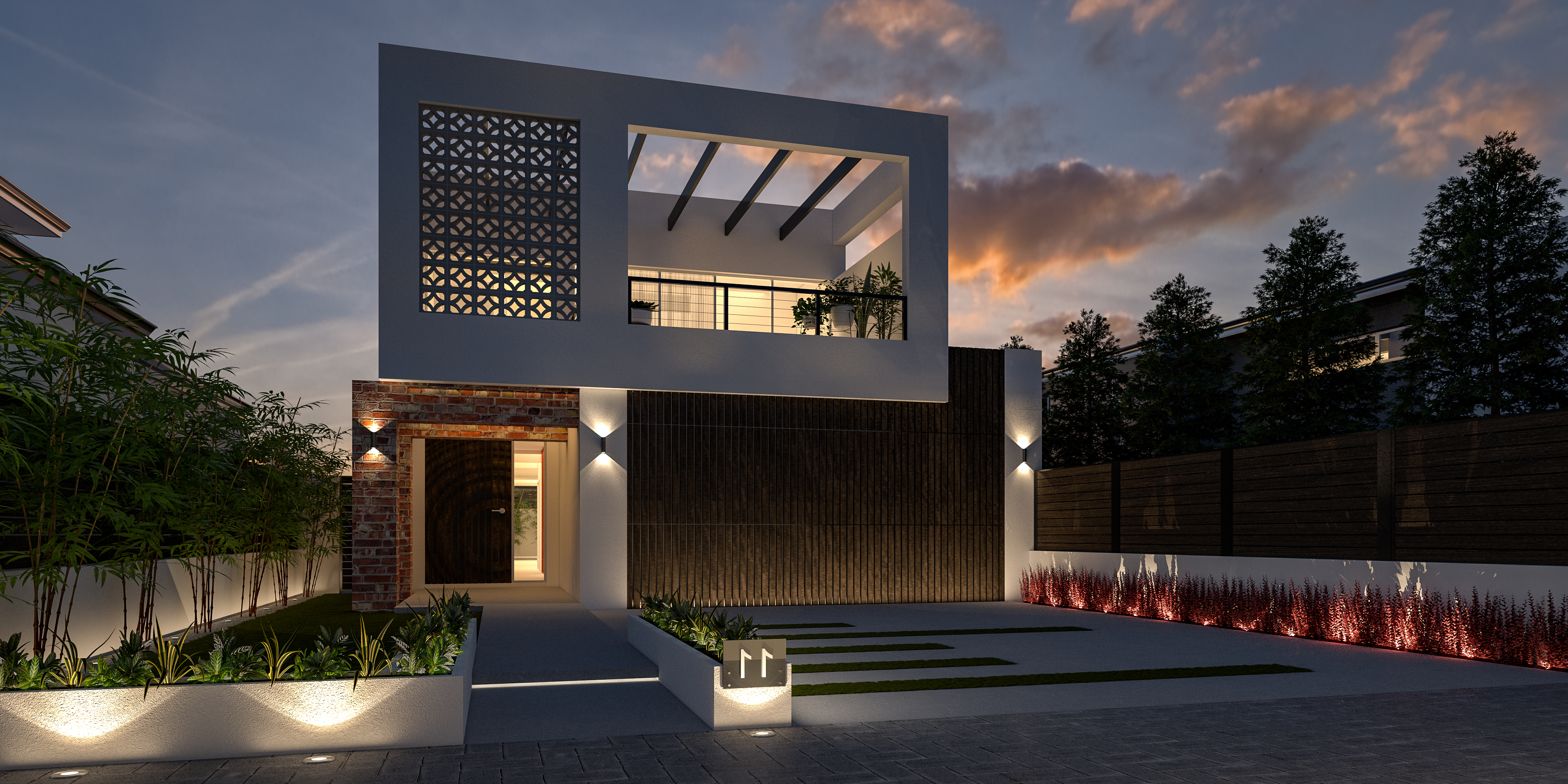 Fontal view of two storey house with white walls, air brics and paved driveway at night with lights burning - Residential Attitudes