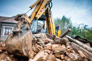 Residential Attitudes - Digger with house rubble